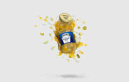 Heinz piccalilli pickle jar exploding in mid air with ingredients