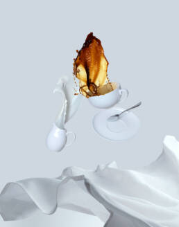 Table cloth pulled away with coffee and cream splashing