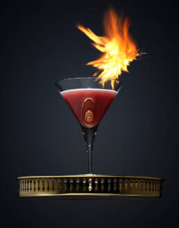 Cosmopolitan cocktail on tray with flame burst
