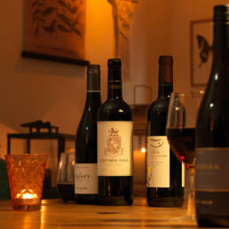 Bolney, Giffords Hall, New Hall and Sharpham red wines on dining table