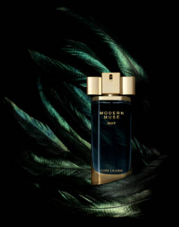 Estée Lauder Modern Muse fragrance perfume with iridescent feathers