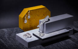 Graff diamonds earrings, bracelet and rings on graphic paper boxes
