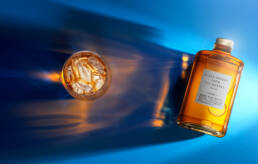 Nikka Whisky from the Barrel on blue background with tumbler