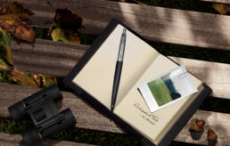 Parker Pens Richmond Black Jotter pen on bench in Richmond Park with notebook, polaroid and binoculars
