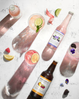 Fruit and Berry flavoured swedish cider by Rekorderlig photographed from above with drinks and garnishes