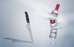 Smirnoff Vodka bottle cut into three pieces by large chef's knife